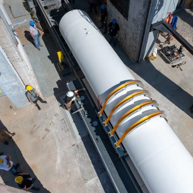 workers buildling a rocket